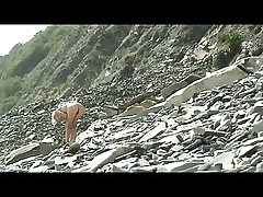 Skinny naked girl by the sea