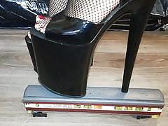 Dame L crush train with sexy black 20 cm extreme high heels.
