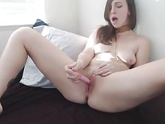 Ultra-cute pretty girl tearing up her pussy with faux-cock