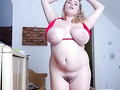 Obese light-haired with giant boobs and fat vagina taking off her bikini