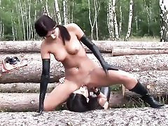 Ultra-kinky bitches dressed in latex in the woods and blowing their pussy crevices