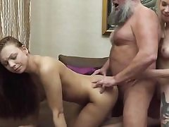 A blonde and a brunette in old and young threesome stiff sex video