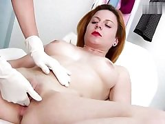 Horny red haired stunner gets her cunt crevice examined on a gyno stool