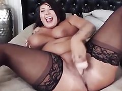 Curvy hottie with huge clapping jug plays with a huge fake penis