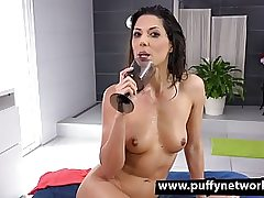 Skinny dark haired whore fucking her pussy with a gigantic dildo